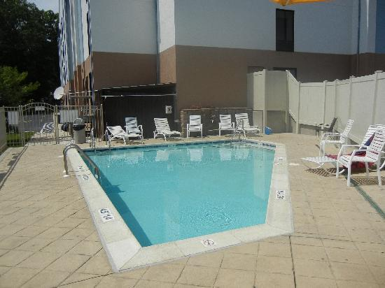 Outdoor pool picture of holiday inn express seaford - Clark s swimming pools seaford de ...