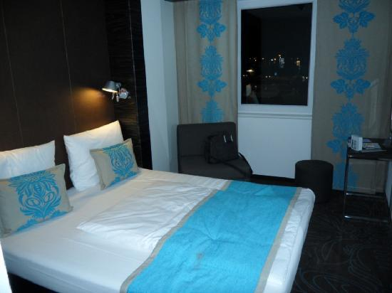 "Motel One Hamburg Airport: The bedroom - very ""compact"" but more than adequate."