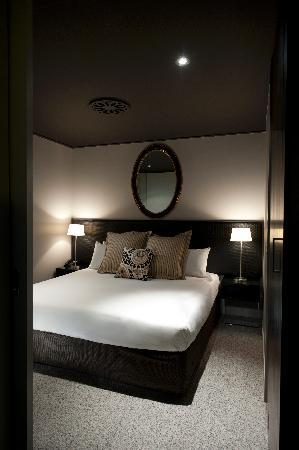 DoubleTree by Hilton Hotel Queenstown: Bedrooms are sleek spaces, with floor-to-ceiling windows infusing natural light.