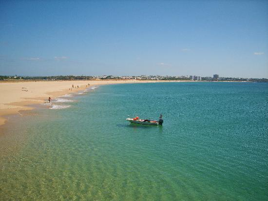 the long sandy beach at alvor
