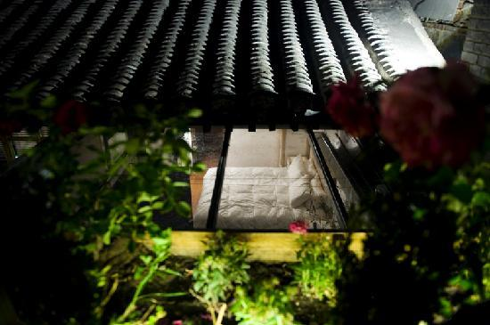 """The Orchid Hotel: One of the """"Three Gardens"""" rooms from the secondf floor patio. The Orchid offers King-size memor"""
