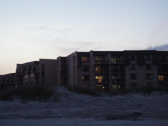Seawatch at the Island Club: view of Sea Watch building from beach at night