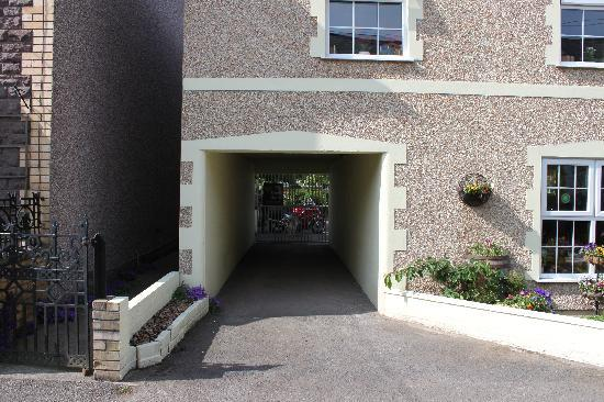 The Guest House: Entrance to the secure rear yard