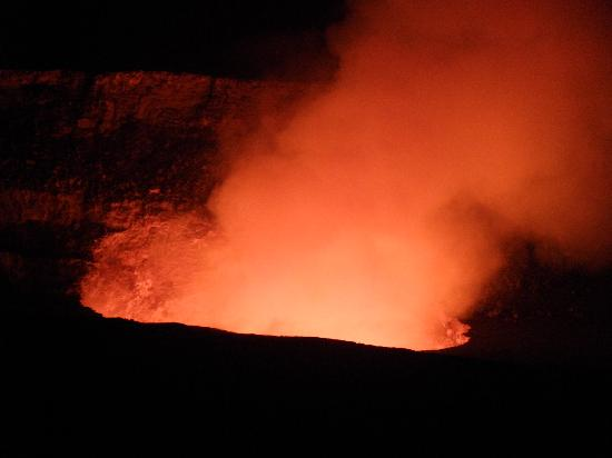 lava illuminates the escaping steam at the volcano - cool!