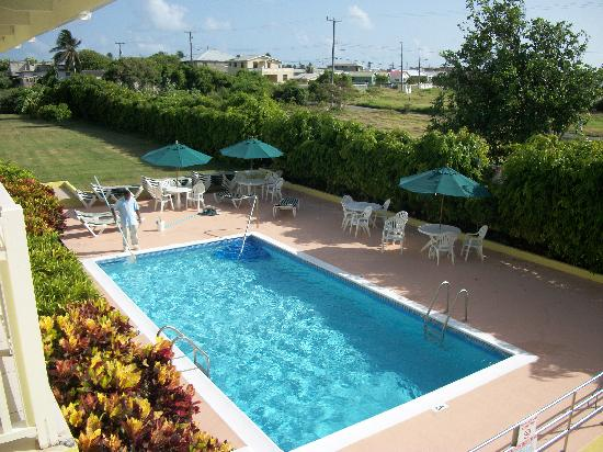 Tropical Winds Apartment Hotel: View of the Pool from Balcony