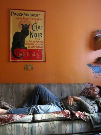 Stray Cat Hostel: The common area is always a good place to nap, chat, snack, or sit down with your laptop