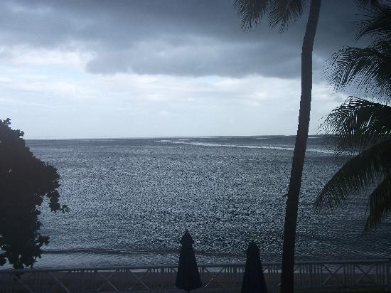 "Villa Beach Cottages: View from room...""a liquid sunshine type day"""