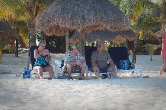 Nachi Cocom Beach Club & Water Sport Center: Relaxing under our straw umbrella