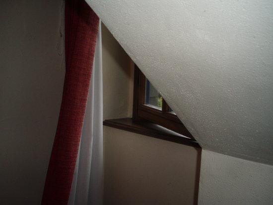 Manoir des Portes : dormer window in bedroom