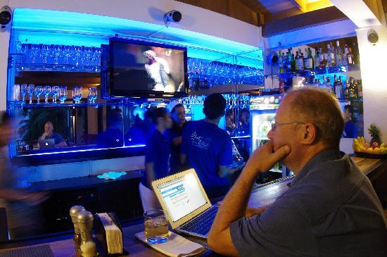 Out of the Blue Resort: My dad having a drink and checking his email at their bar
