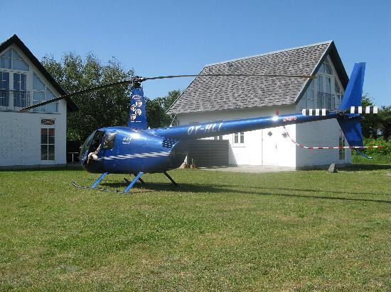 Laesoe Island, Danemark : Guests traveling with their own helicopter. In the background you see the two new guest houses f