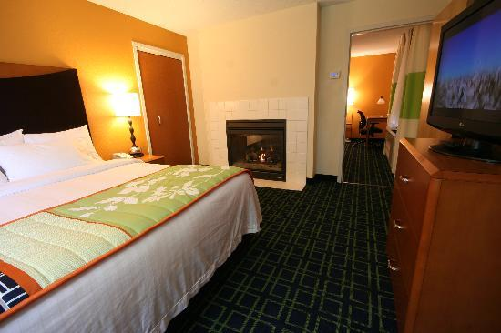 Fairfield Inn & Suites White River Junction: Our two room Executive Suite features a King bed with double sided fireplace.