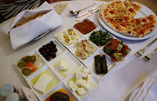 Room service. Margarita pizza and Lebanese sampler