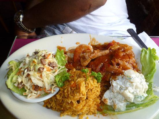 Cuzzin's Caribbean Restaurant and Bar: Conch and shrimp in creole sauce, potato salad, rice & peas and coleslaw