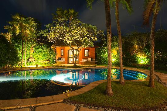 The Villas Bali Hotel & Spa: the pool by night