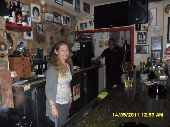 The Flaming Greek Garden : Our gracious bartender and DJ cum owner of Flaming Greek