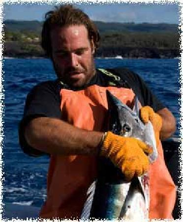 Lava Ocean Tours Inc : Captain Dan boating another Ono fish, guess we know whats for dinner!!