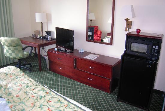 Fairfield Inn & Suites Jacksonville: Shot of desk, bureau, etc. Sorry for the mess. I was leaving & didn't close everything up.