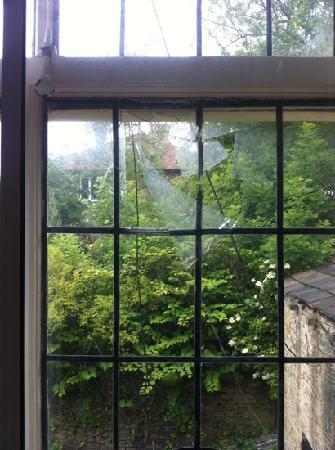 The Stump Cross Inn: the smashed window