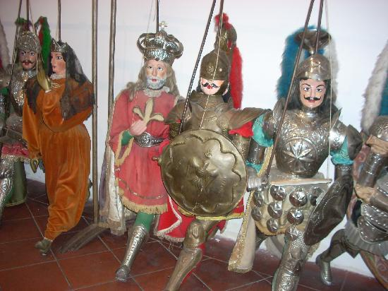 Palazzo Corvaja: Marionettes on display inside the tourist bureau.