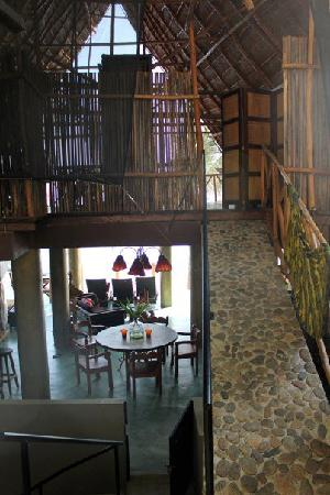 Casa Pericos: Two floors. Top is hammocks & king size beds. Bottom is kitchen / living room. Photo taken from