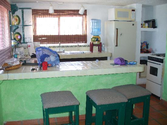 Siesta Suites: kitchen area to left of entry