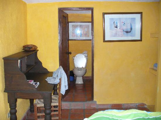 Siesta Suites: desk in bedroom & door to bath room