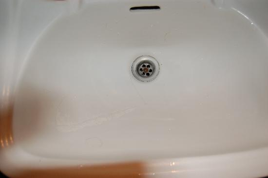 Hotel Hermes: Cracked basin, painted with emulsion to hide cracks