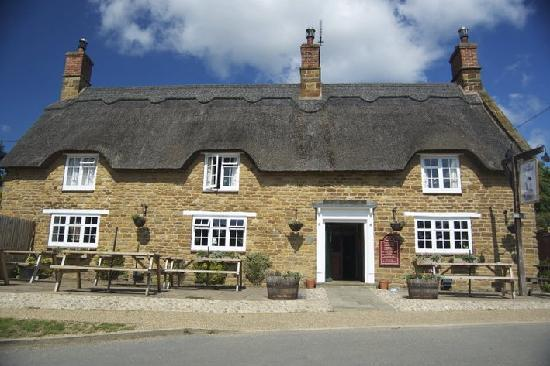 The Windmill at Badby: The outside of The Windmill. A great spot for drinks in the sunshine.