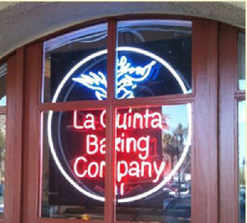 Sign of La Quinta Baking Company