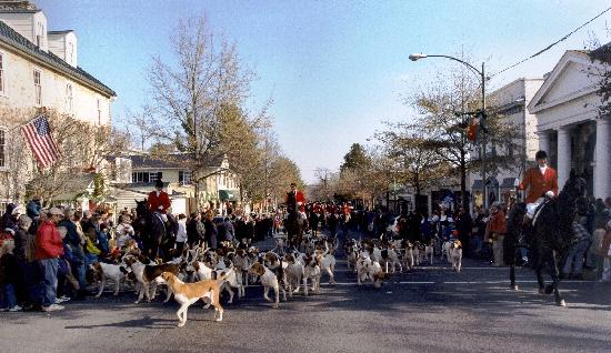 the hunt parades down main street during the annual christmas in middleburg
