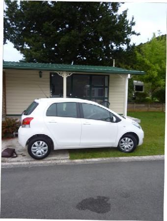 Kauri Coast Top 10 Holiday Park: My car outside the cabin