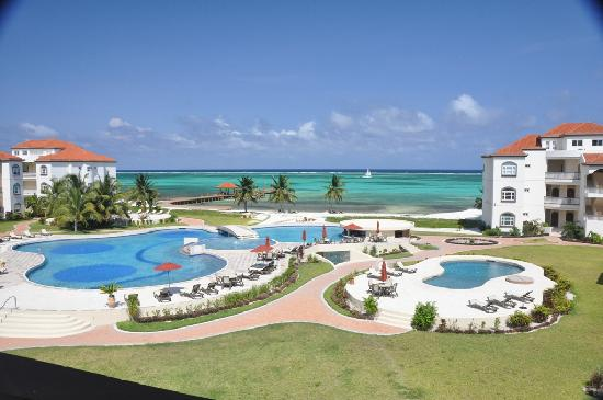 Grand Caribe Belize Resort and Condominiums: View of pool and ocean from our deck