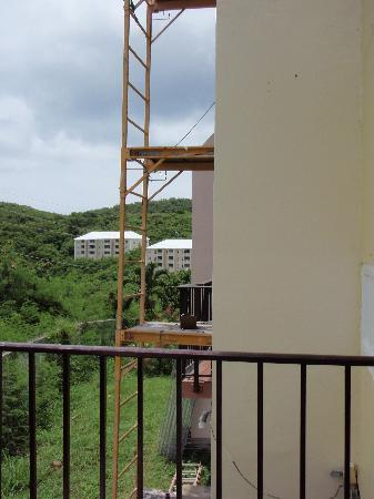 Flamboyan on the Bay Resort & Villas: Moving along on outer building: mortar, prime and fresh paint