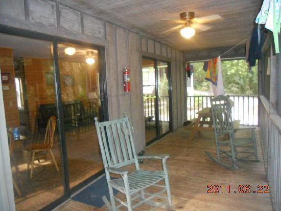 Rainbow Rivers Club: porch screend in with rocking chairs