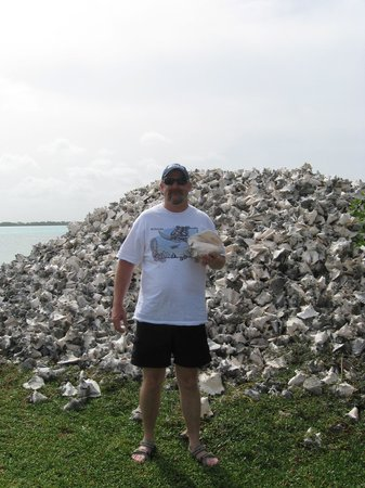 Lac Bay: Hubby standing by one of the conch piles