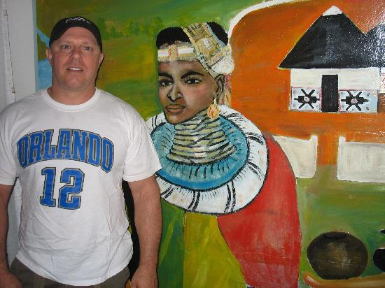 Soweto, South Africa: Rob next to the great paintings in the main room