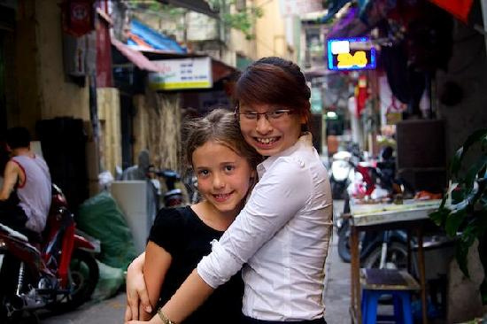 Hanoi Charming Hotel: Ruby and Lien in the Street Outside Charming