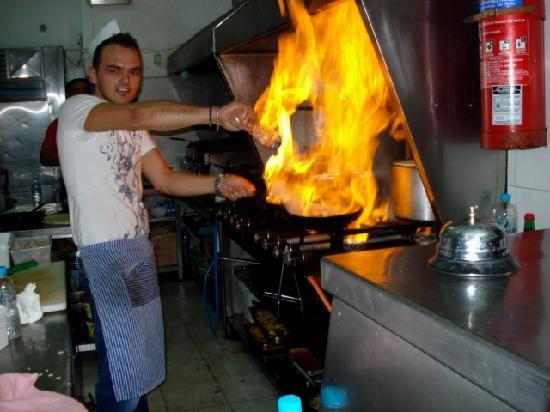 Head Chef In Action Kitchen On Fire Picture Of