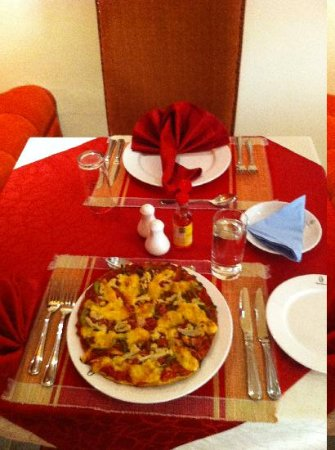 Kigali Guestlux Hotel: African Pizza from Kigali's Guestlux