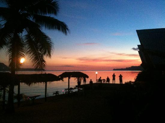 Sun setting on the beach at Moorings Hotel