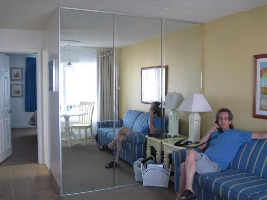 The Concord Suites: Me on couch, and hallway to bath & bedroom