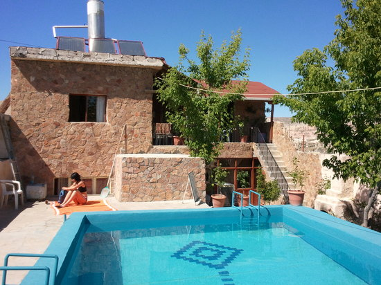 Cappa Cave Hostel: View of the pool and our room overlooking it