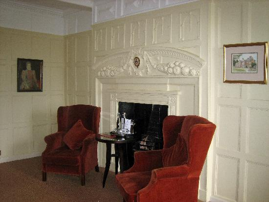 Hatherley Manor: The fireplace,panelling and picture's