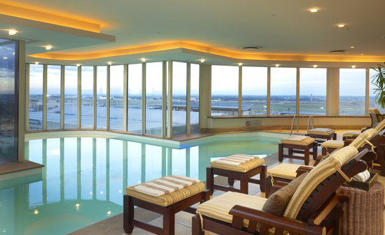 InterContinental Johannesburg OR Tambo Airport : Swim in our heated pool or enjoy a treatment at Camelot Spa overlooking the airport and city sky