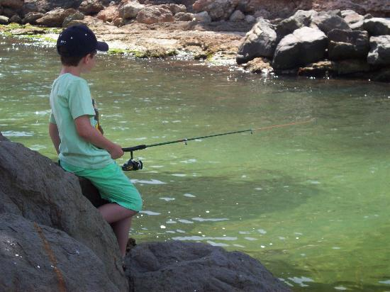 Hotel Cala Galdana & Villas d'Aljandar: our grandson learning how to catch fish