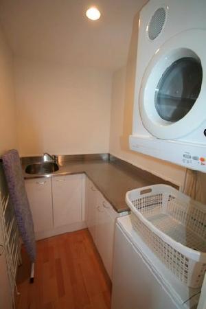 Latitude 37 Accommodation Ltd: Laundry of 2bed 2bath waterfront apt