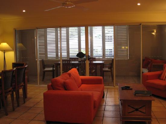 Cayman Villas: lounge with glass doors, no curtains