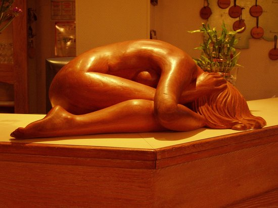Bollezéele, France : This beautiful wood carving lives on the reception desk!
