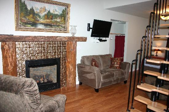 The Cabins at Beaver Creek: Fireplace, couch, chairs